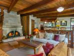 The great room was built using rock from the creekbed and reclaimed timbers. Take advantage of all that plush seating...