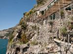 The view of the villa from the sea, inside the cliff
