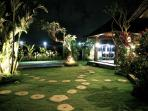 Night view of the garden, pool and dining place