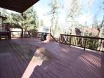 two decks on main floor with BBQ and outdoor picnic table