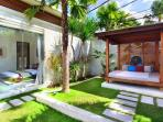 Relax in a shadowed  gazebo under palm trees