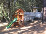 Your kids will love this play structure and many other toys in the fenced yard