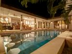 Pool and living room at night