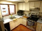 Kitchen with brand new gas range