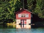 Our red boat house is the keystone of Trout Lake