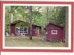 The Guest House is located under towering pines about 75 feet from lake.