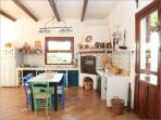 The big, fully equipped kitchen with its working wood oven
