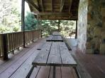 Large deck on front overlooking a great field for fun activities