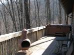 Deck along side of house with private hot tub that's 'above it all'.