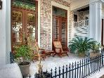 The front porch of this Le Jardin townhome is a perfect place to