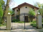 • The Villa lies approx. 20 m off the road. The car gate opens automatically.