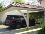 • Under the carport there is space for one more car.
