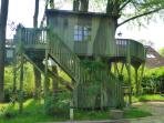 • The magnificent tree house is a fantastic playground. With stereo, table and sofa.
