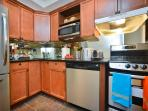 Kitchen with stainless steel appliances including dishwasher