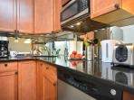 Black granite counter top in kitchen with small appliances
