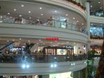 SHOPS INSIDE GIANT ROBINSONS PLACE MANILA MALL BESIDE THIS CONDO APARTMENT