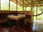 Looking from the main room out to the deck, a great place to swing in a hammock or bird watch