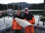 Hosts Brent & Raewyn with freshly caught halibut