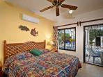 This bedroom also has a view of the pool and garden, and it has a private bath