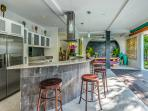 Fully Equipped Kitchen and Breakfast Bar with Dining in background - morning light