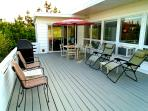 Ocean-side deck with grill and umbrella