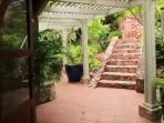 Descend the Stone Steps through a Lush Garden of Tropical Flowers.....