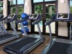 Treadmills overlook the pools