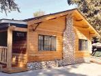 Charming Cedar, Stone, and Log Exterior
