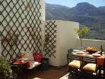 Dining on our south facing terrace, surrounded by the mountains of Granada.