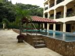 BBQ and outdoor dining / entertainment area beside infinity pool