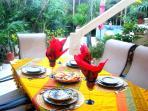 Bed and Breakfast Near Tulum - Outdoor breakfast table in tropical garden -