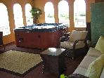 Veiw of your private hot tub with LED lighting 42 inch tv surround sound couches and dining tables