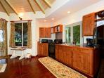 Hand crafted, custom teak cabinetry and major appliances in the kitchen at Aloha Cottage.
