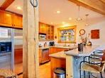 Stainless steel appliances & bar seating