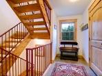 Stairwell leading to loft and garage