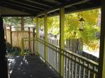 the front porch in the fall (the cottonwood tree is turning color)