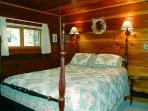 Bedroom 1 with a queen bed, main floor