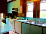 Tiffany Blue Kitchen stocked with pots, pans, and appliances