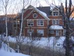 view of condo in winter