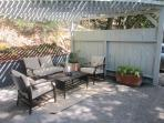 The patio has a conversation area for relaxing and discussing the days events.