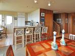 Looking from the dining area toward the kitchen and entry.