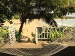 Relax on our hammock and read our book whilst looking over the beach.
