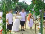 wedding in front of beach seawall behind
