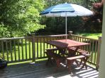 Deck with view of pond