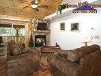 A leather sleeper sofas surround the gas log fireplace and satellite TV DVD player.