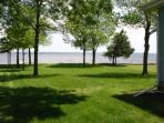 60' pier, beautiful shade trees, and a plush weed-free back yard and all yours to enjoy!