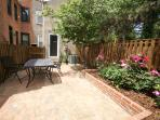 Rear courtyard with table and Grill