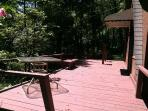 huge deck with swing and outside dining