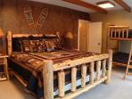 Mountain bedroom: king bed, bunk bed, four closets, and a private deck.