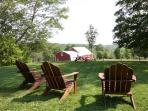 Looking across the front yard toward the animal pasture and big red barn.